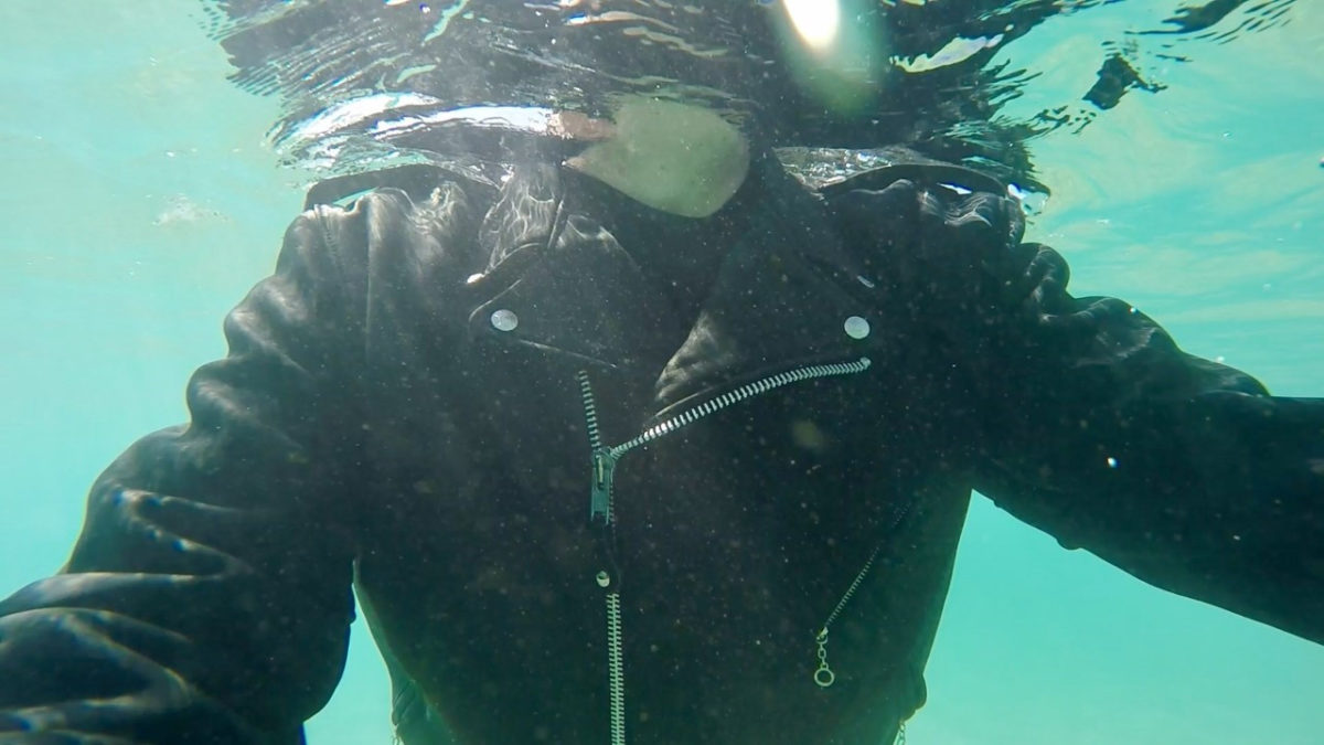 Swimming in leather jacket
